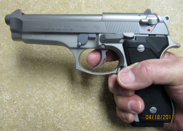 Holding the Beretta 92FS in Hand