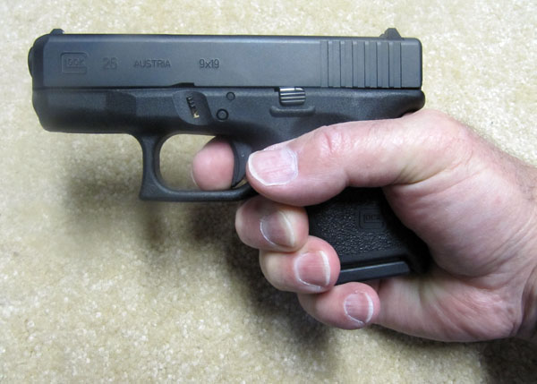 Holding Glock 26 with 10 Rd Magazine
